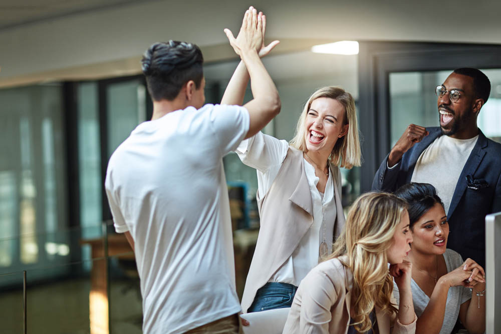 Resident High Fiving at ther Workplace
