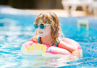 child_floating_in_pool