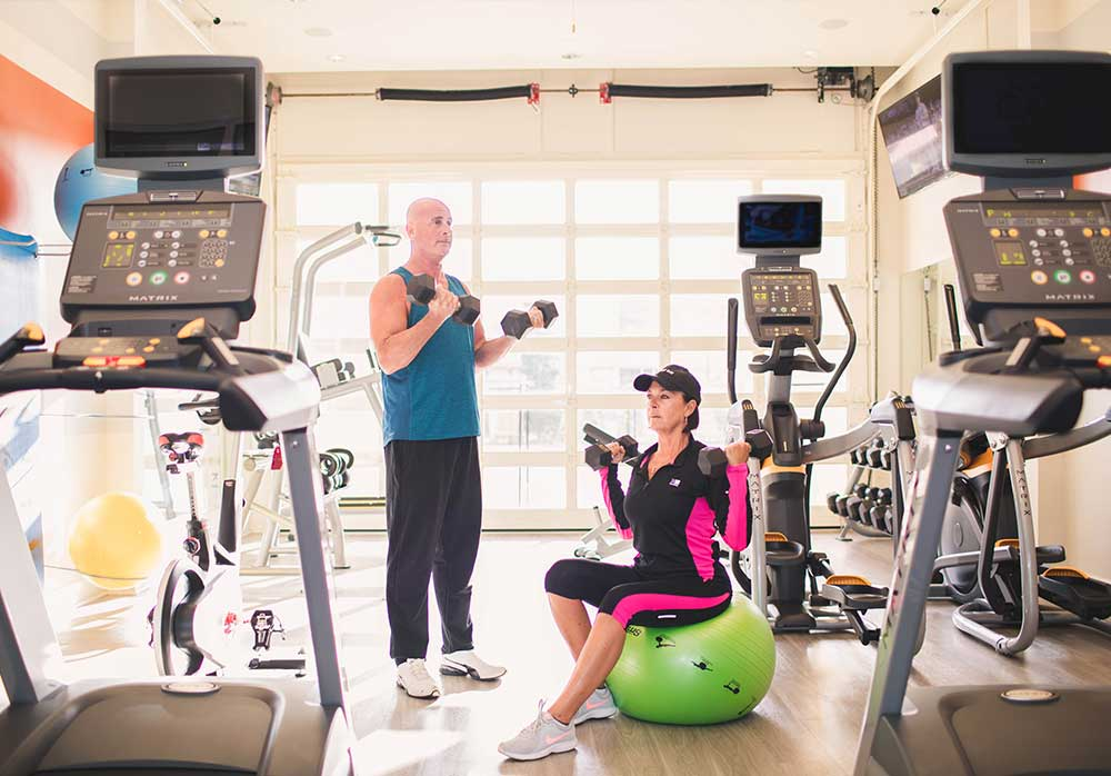 couple working out in fitness center
