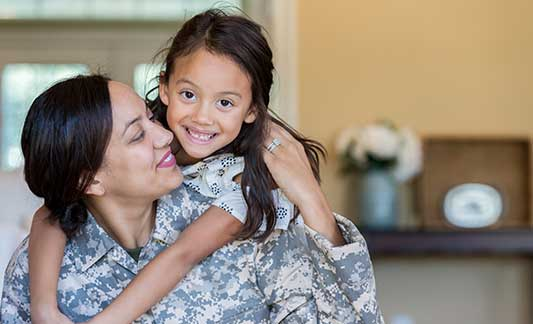 happy military mom and daughter