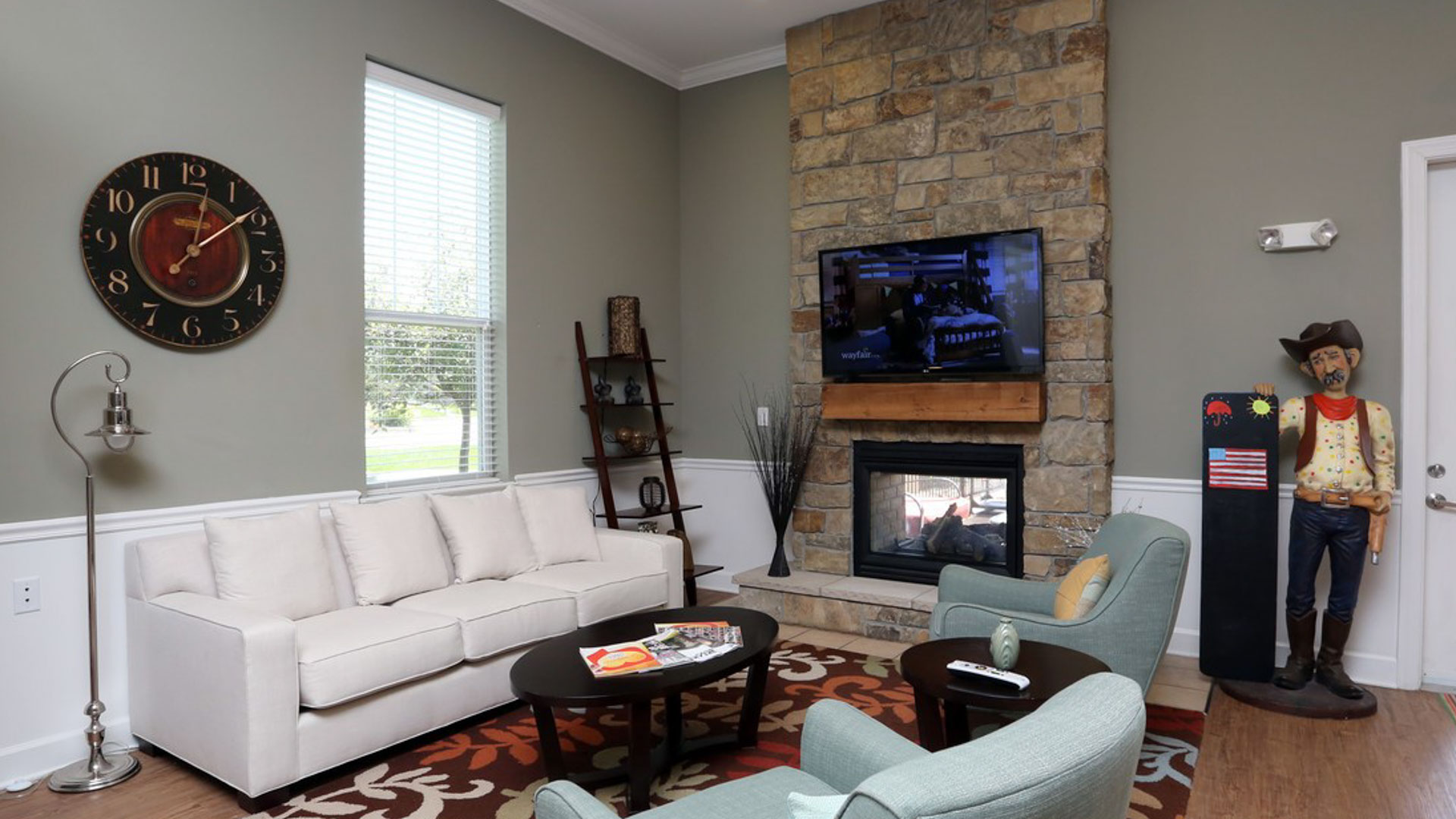 Clubhouse lounge and fireplace at Springs at Bettendorf Apartments in Iowa