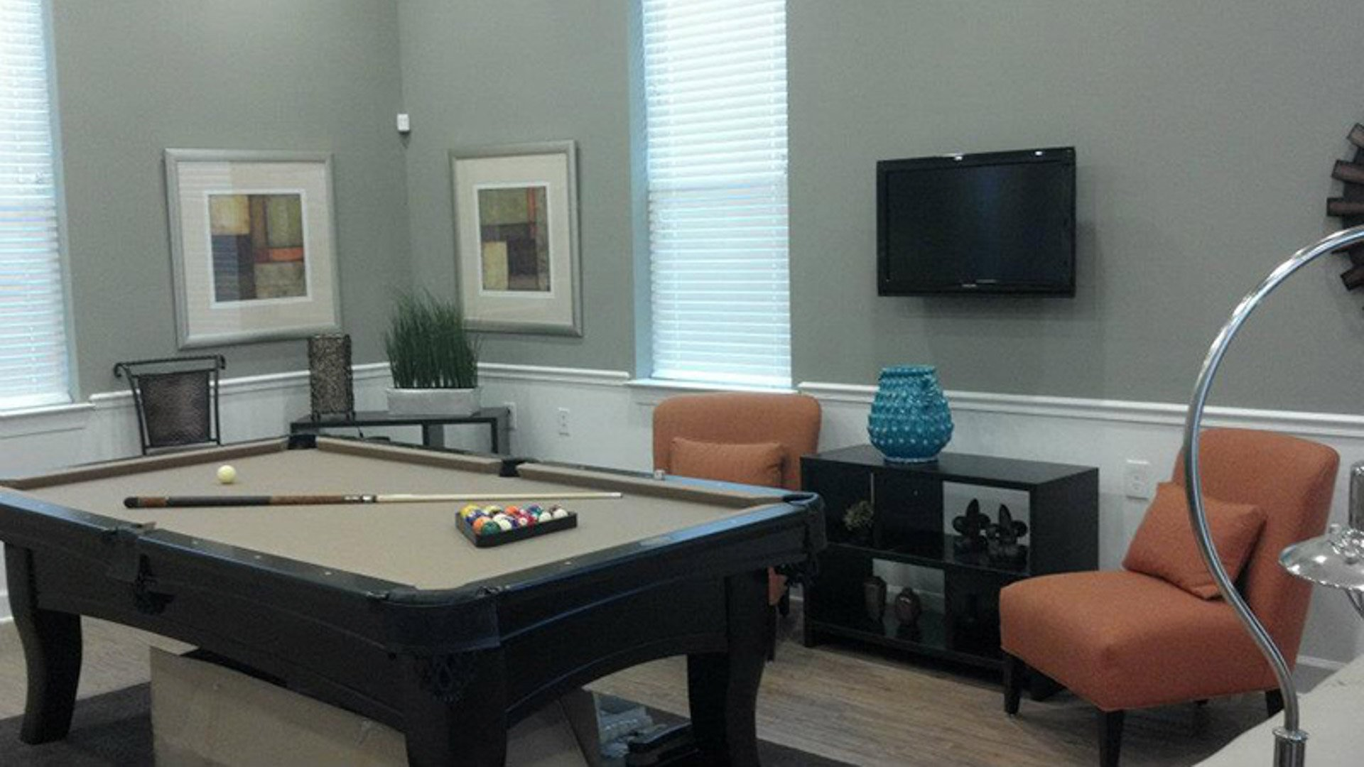 Pool table in the clubhouse and TV at Springs at Bettendorf Apartments in Quad Cities-12