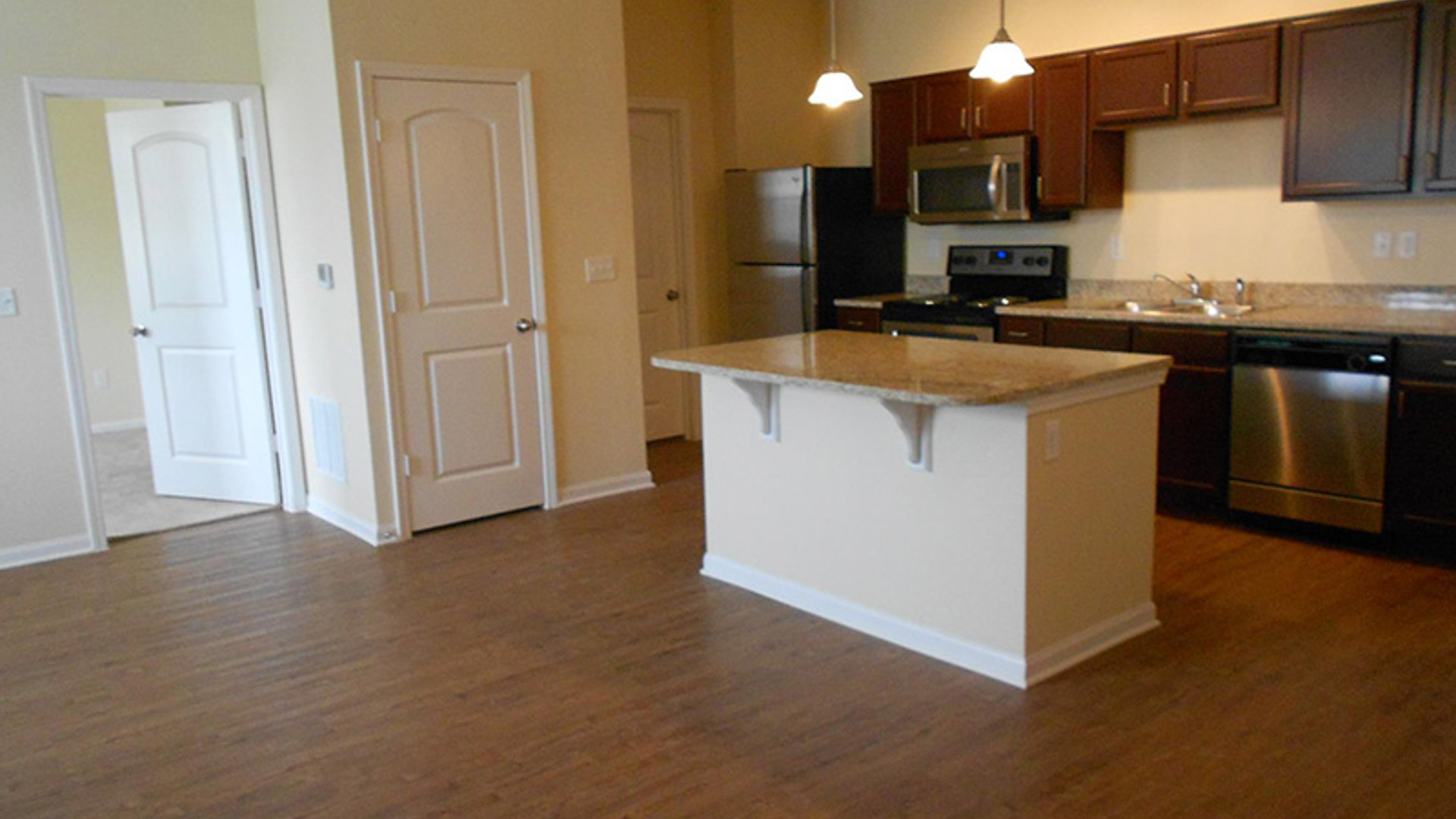 Upgraded kitchen with stainless steel appliances at Springs at Bettendorf Apartments in Iowa