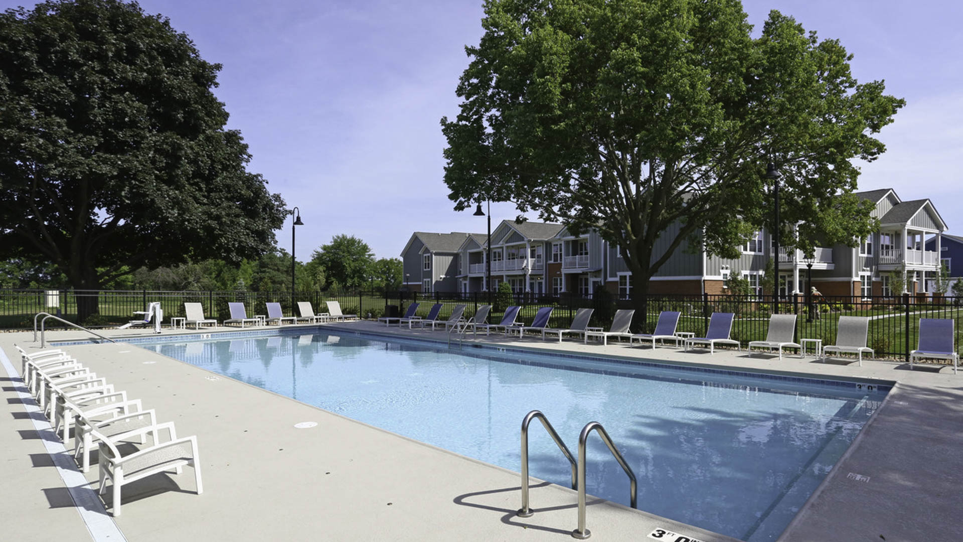 Springs at Canterfield pool and apartment exterior  in West Dundee, IL
