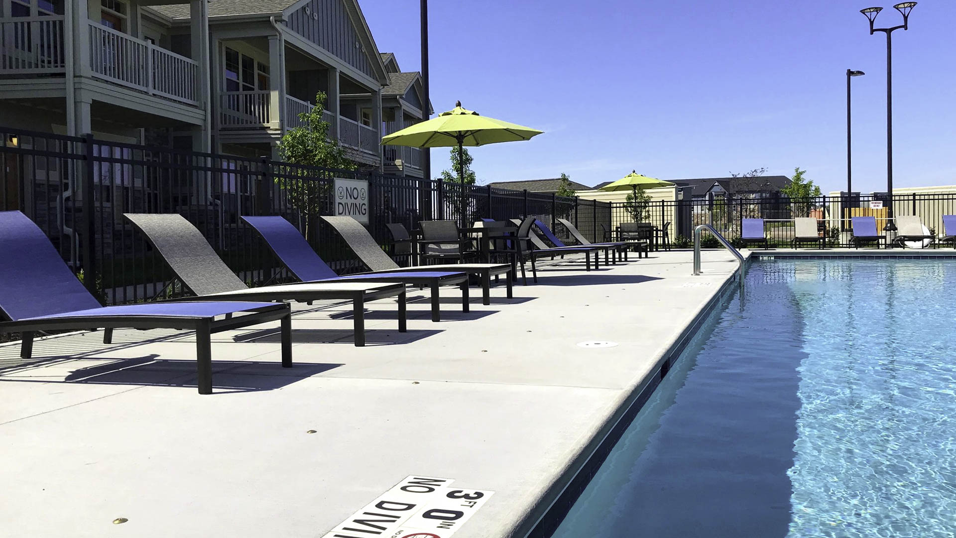 Springs at Cobblestone Lake pool and apartment exterior