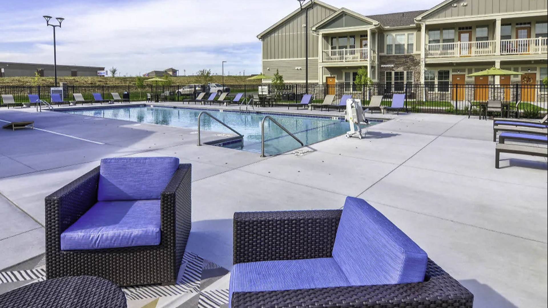 Springs at Cobblestone Lake pool and seating area