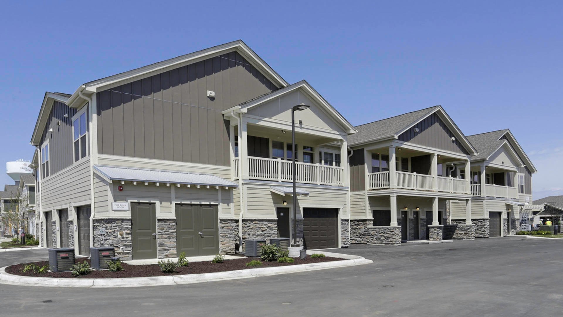 Springs at Cobblestone Lake apartment exterior with attached garages