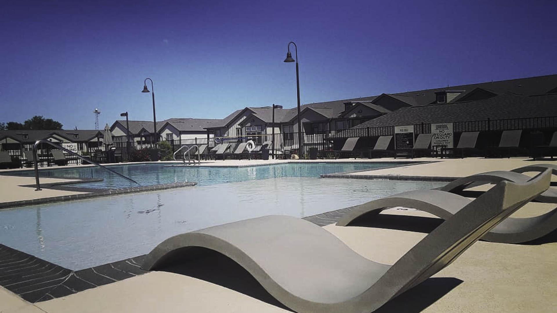 Springs at Cottonwood Creek pool lounge chairs