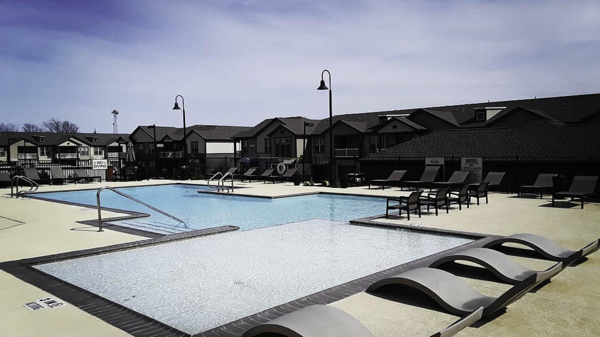 Springs at Cottonwood Creek pool and apartment exterior