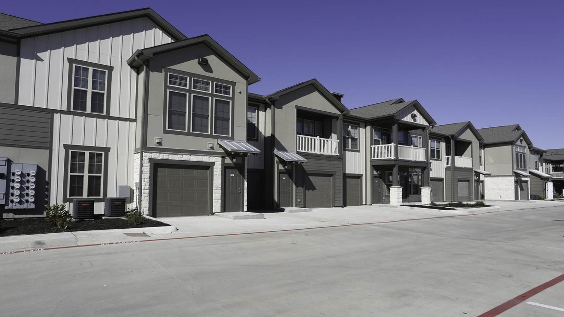 Springs at Cottonwood Creek apartment exterior with attached garages