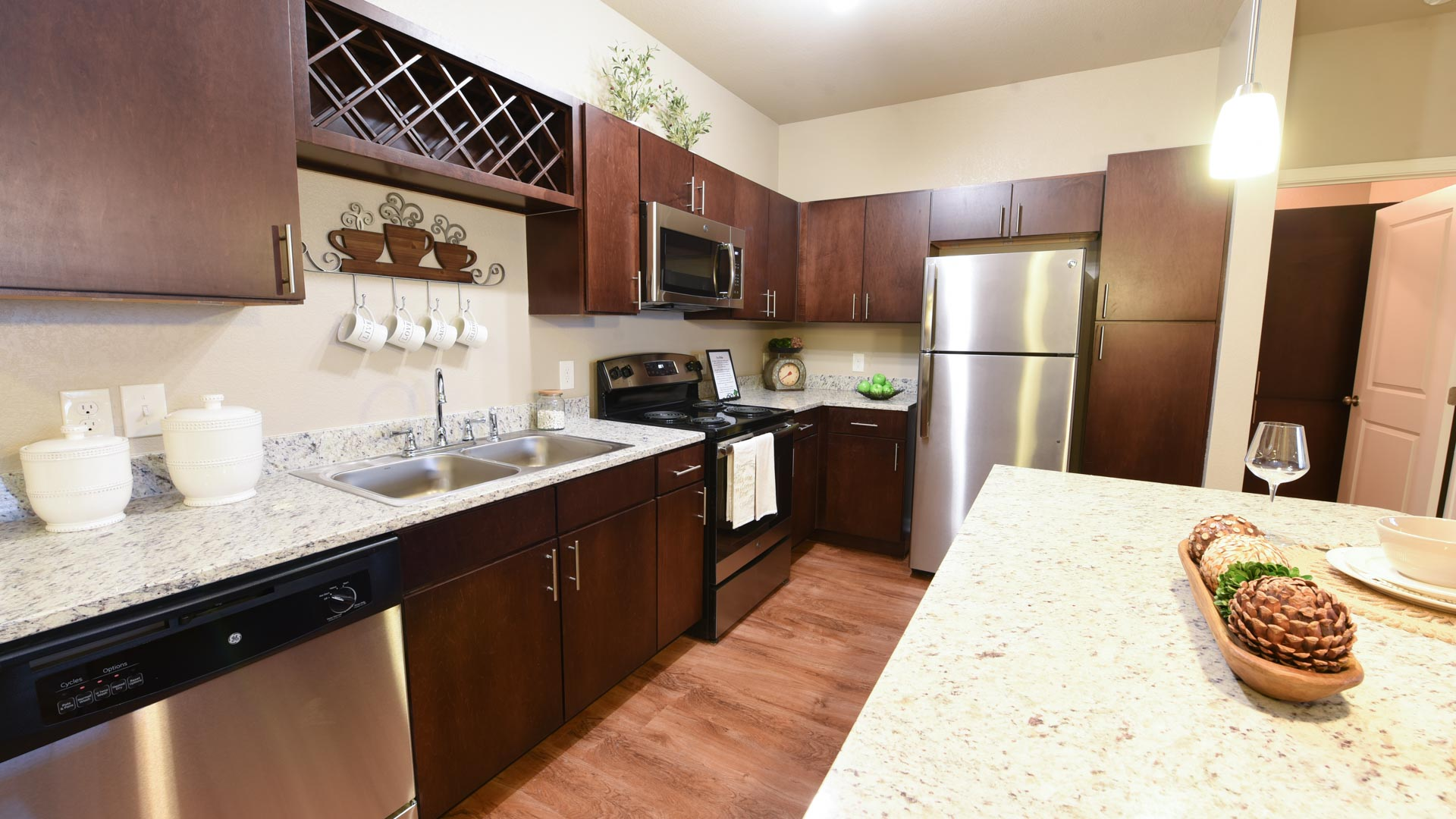 Stainless steel appliances and wine rack at Springs at Foothill Farms in Colorado Springs-14