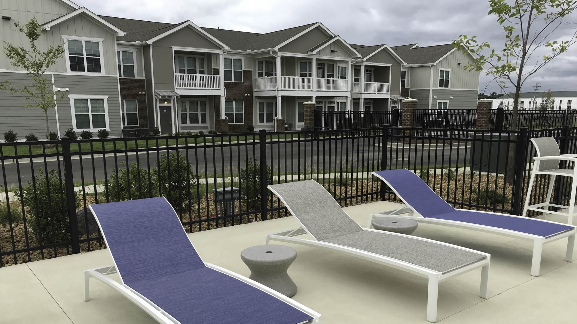 Springs at Forest Hill outdoor seating and apartment exterior