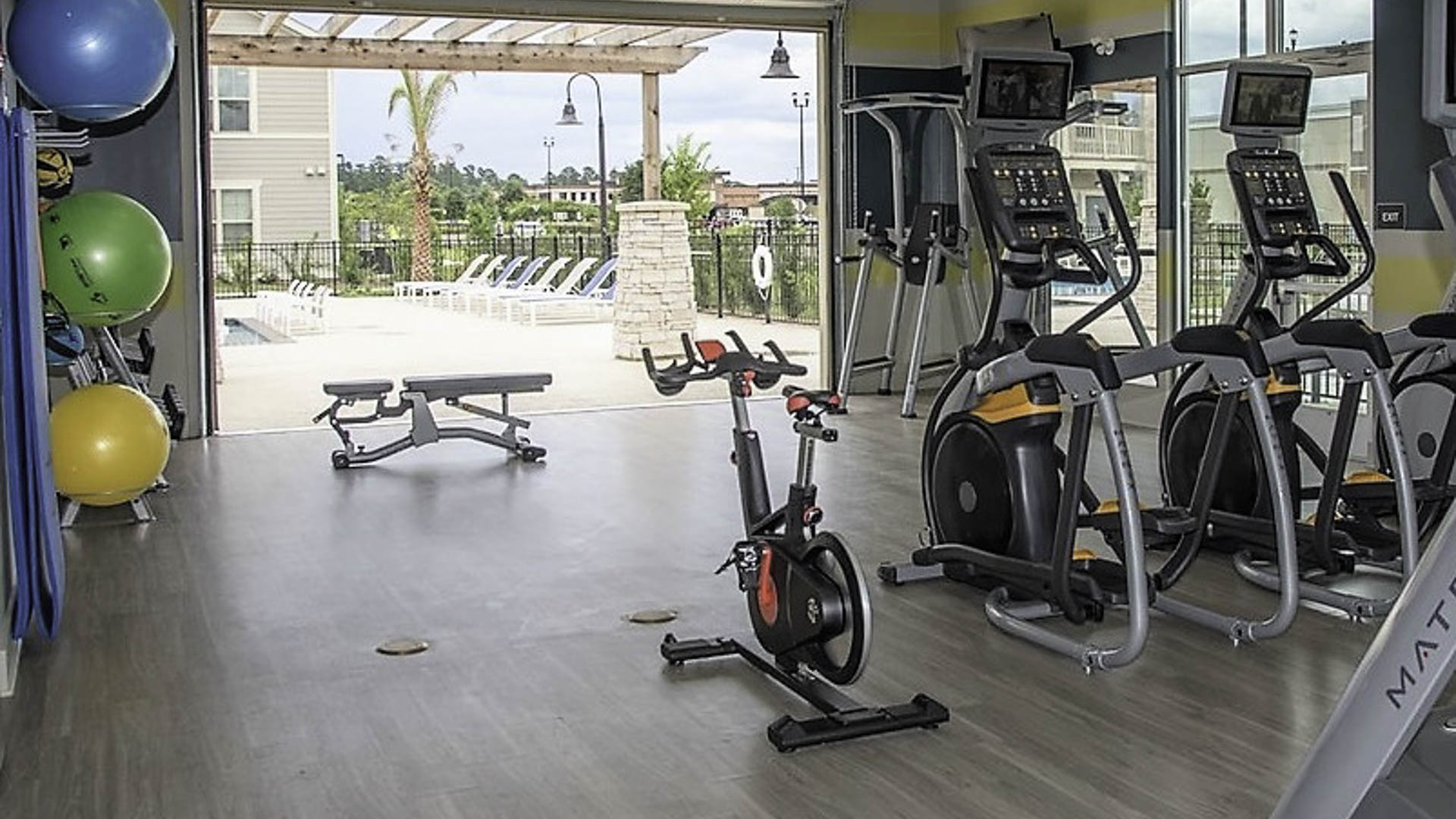 Springs at Juban Crossing fitness center with open garage