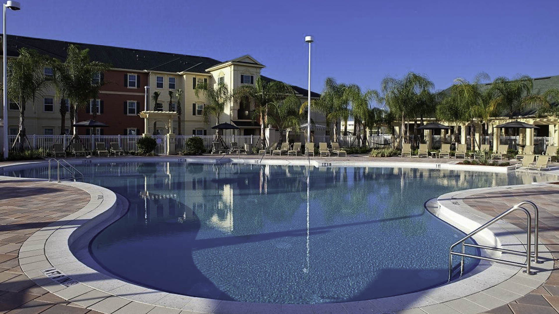 Lost Creek at Lakewood Ranch pool during the day and apartment exterior