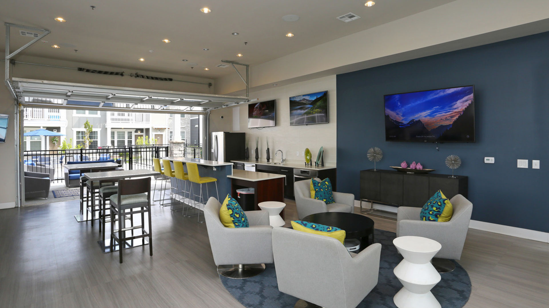 TV Lounge and Kitchenette in North Aurora at Springs at Orchard Road Apartments-12