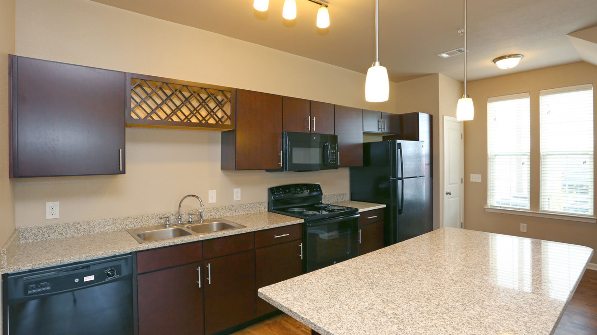 Kitchen with Granite in North Aurora at Springs at Orchard Road Apartments-23
