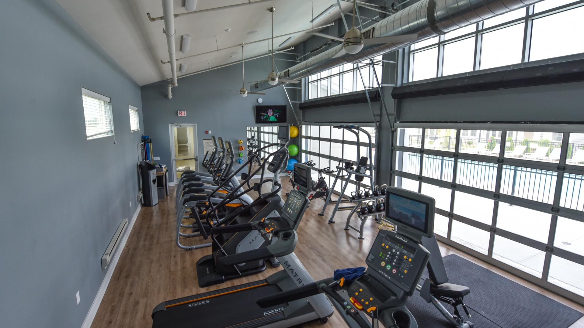 Gym that opens to the Pool at Springs at Orchard Road in North Aurora, IL-14