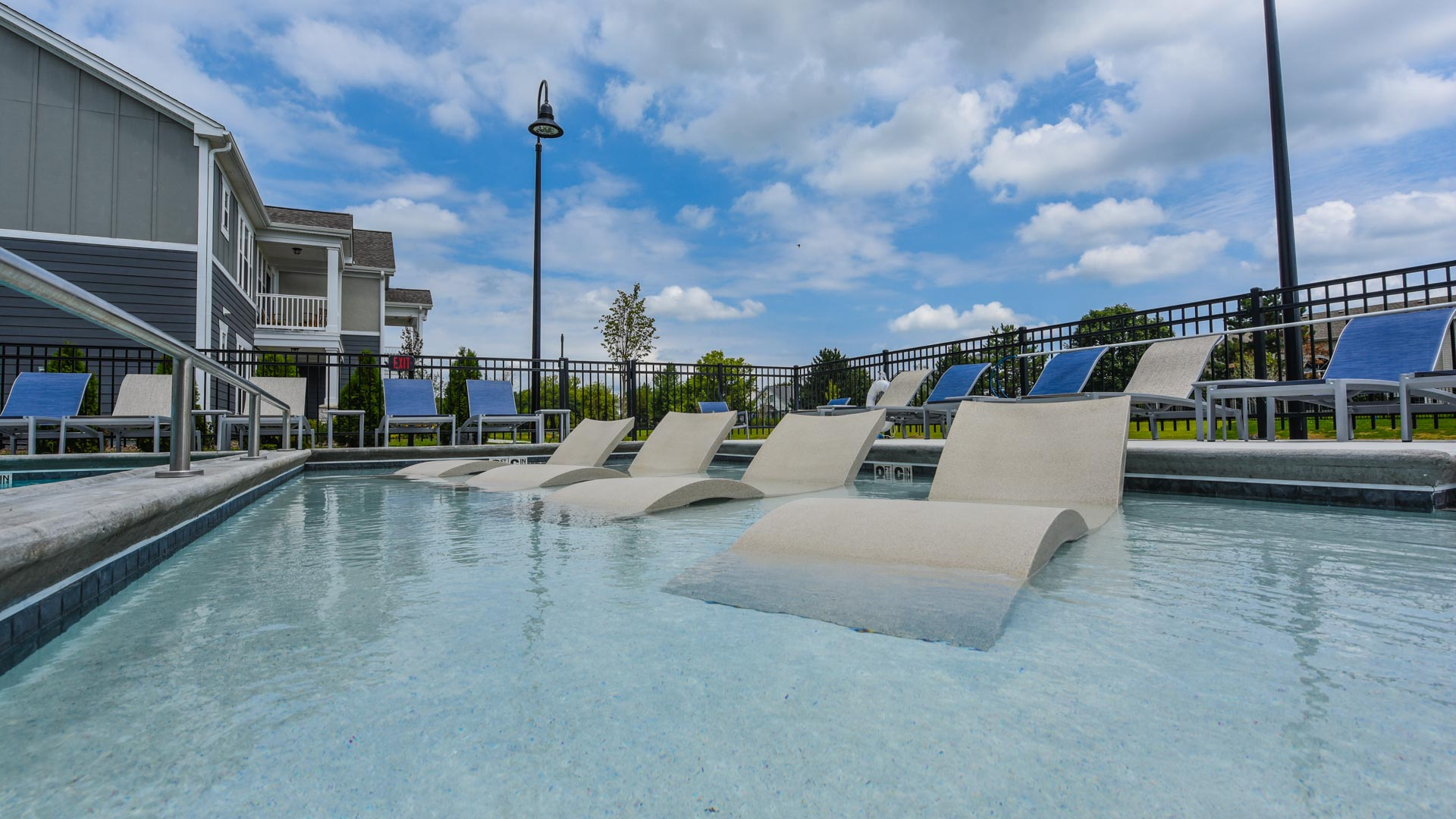Lounge Chairs in the Pool at Springs at Orchard Road in North Aurora, IL