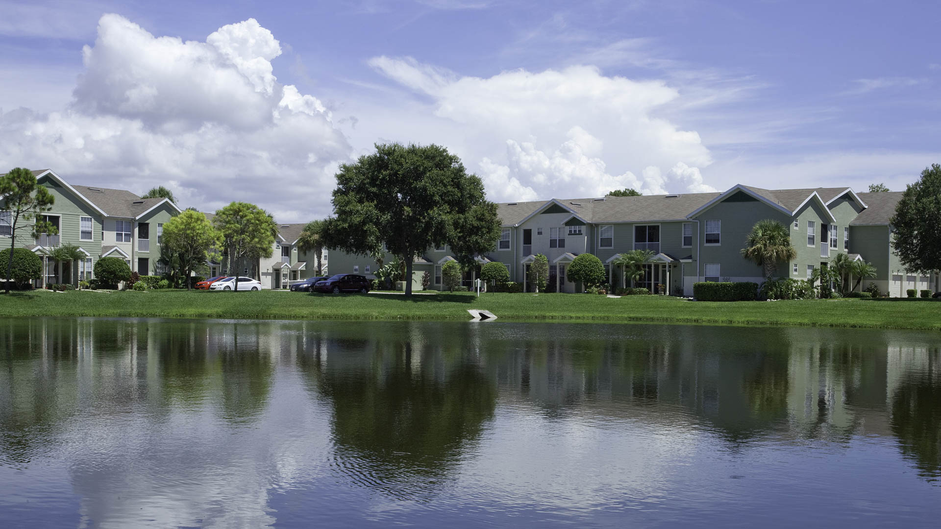 Springs at Palma Sola pond and apartment exteriors