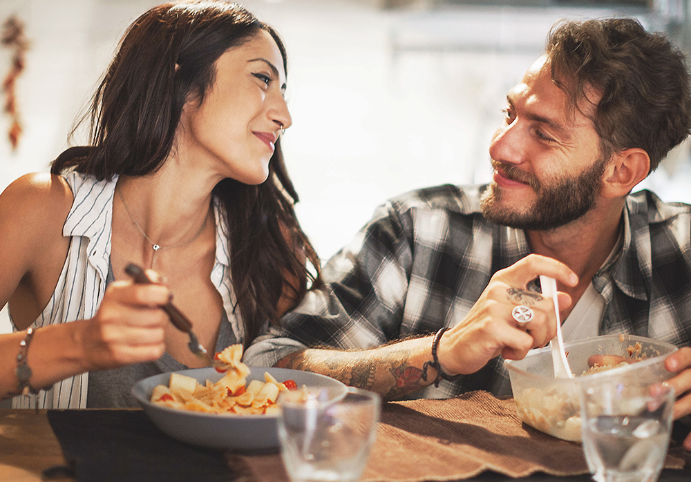 Couple Eating Dinner at Granite Countertop at Springs at Red Mountain Luxury Apartments