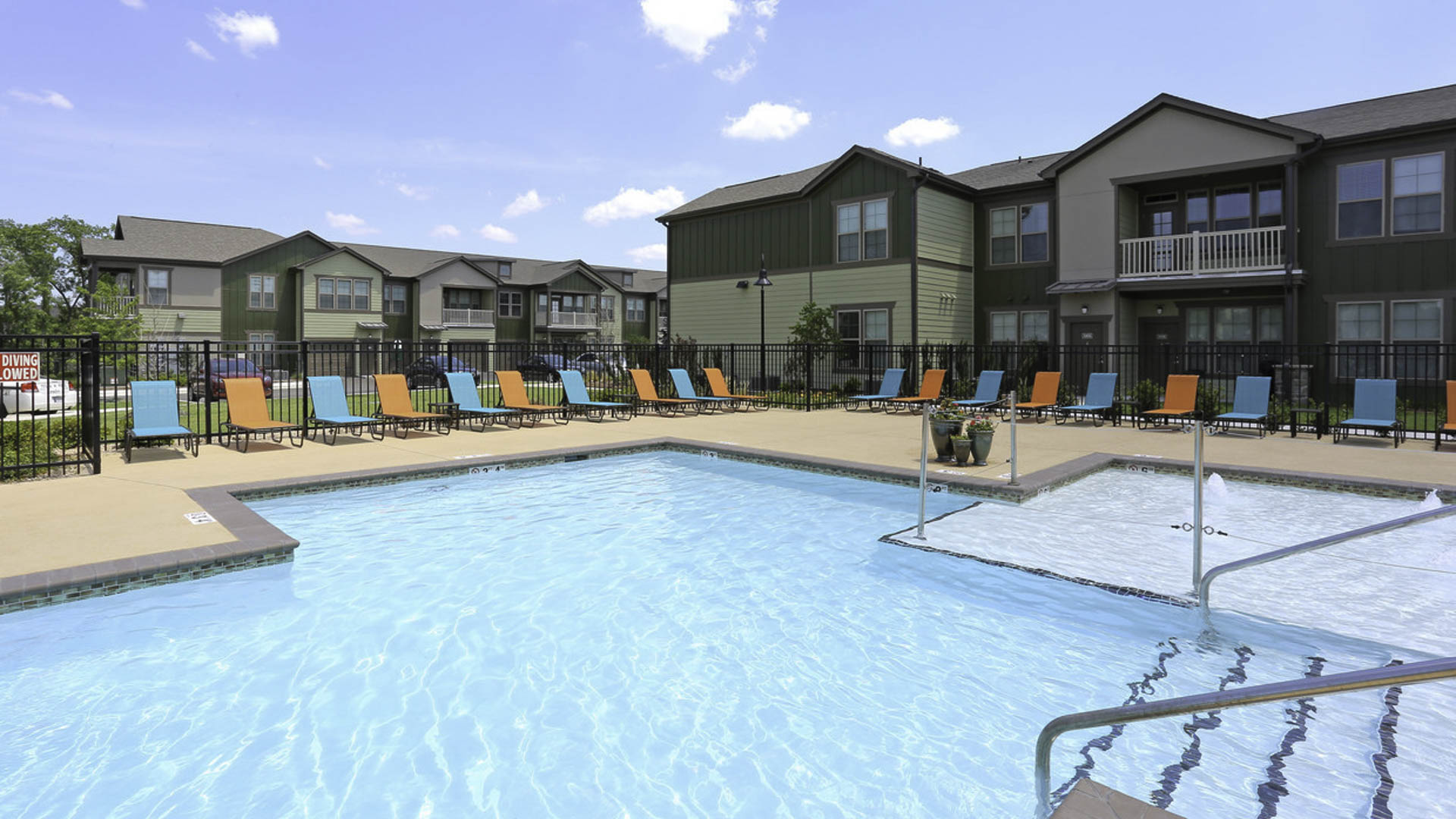 Springs at Woodlands South pool and apartment exteriors