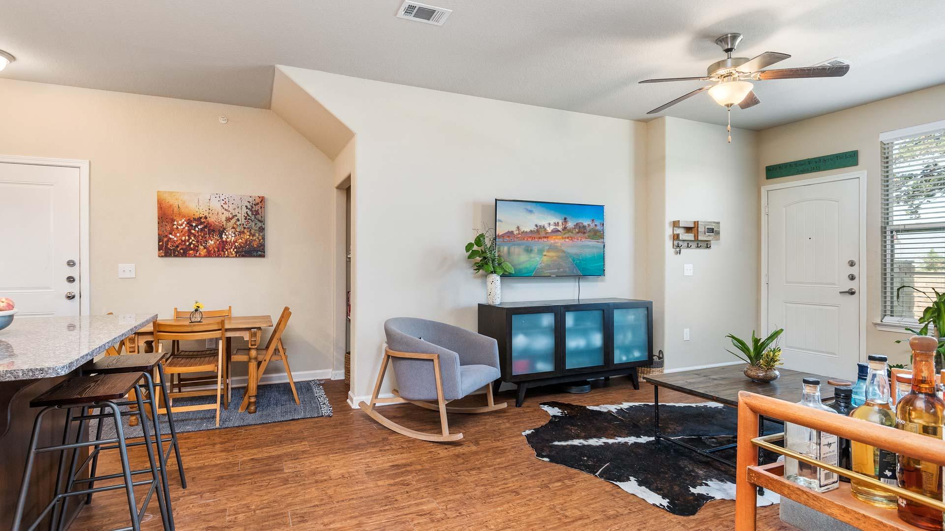 TV and dining room in San Antonio at Springs at Alamo Ranch