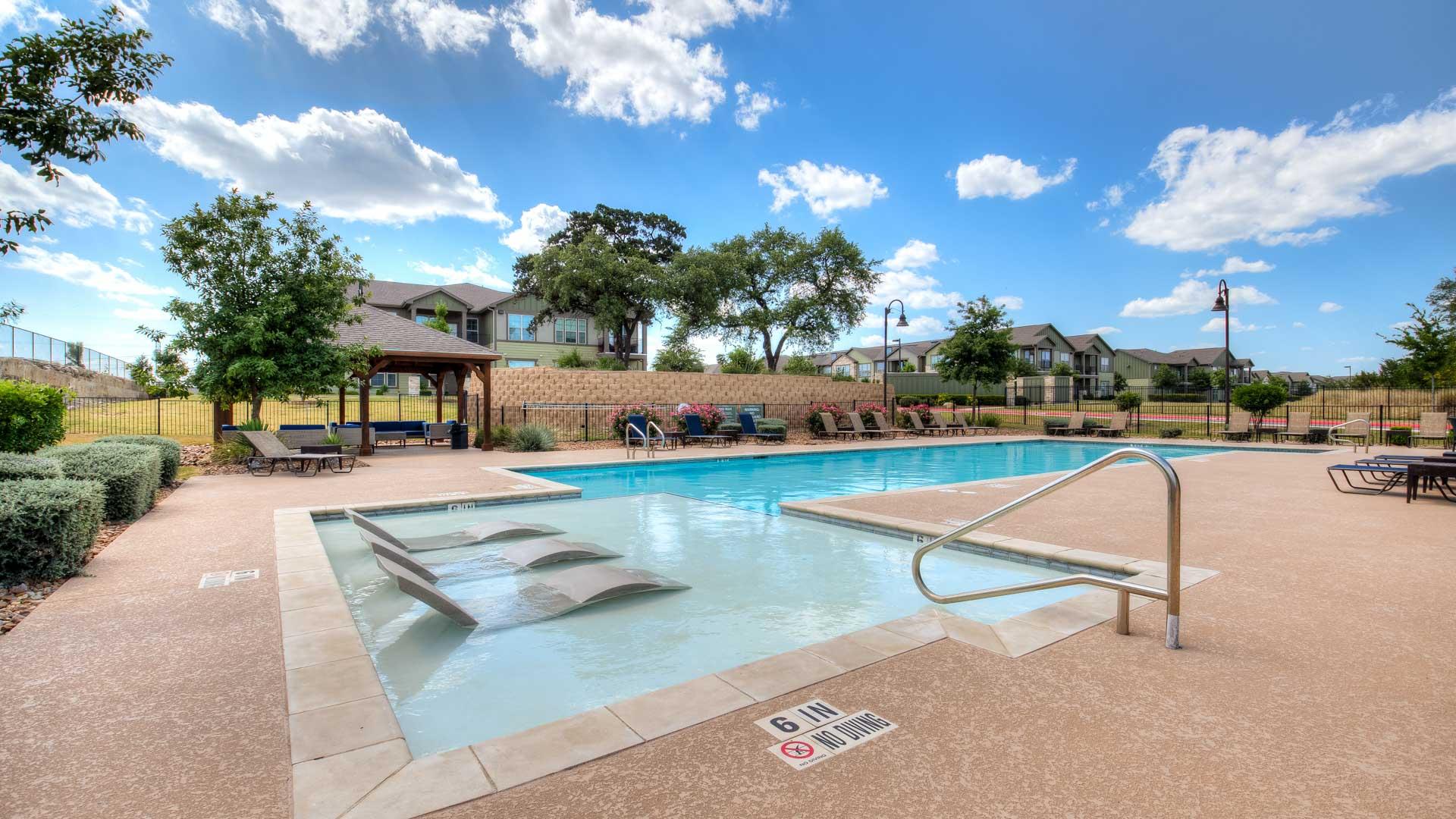 Pool Lounge Area in San Antonio at Springs at Alamo Ranch