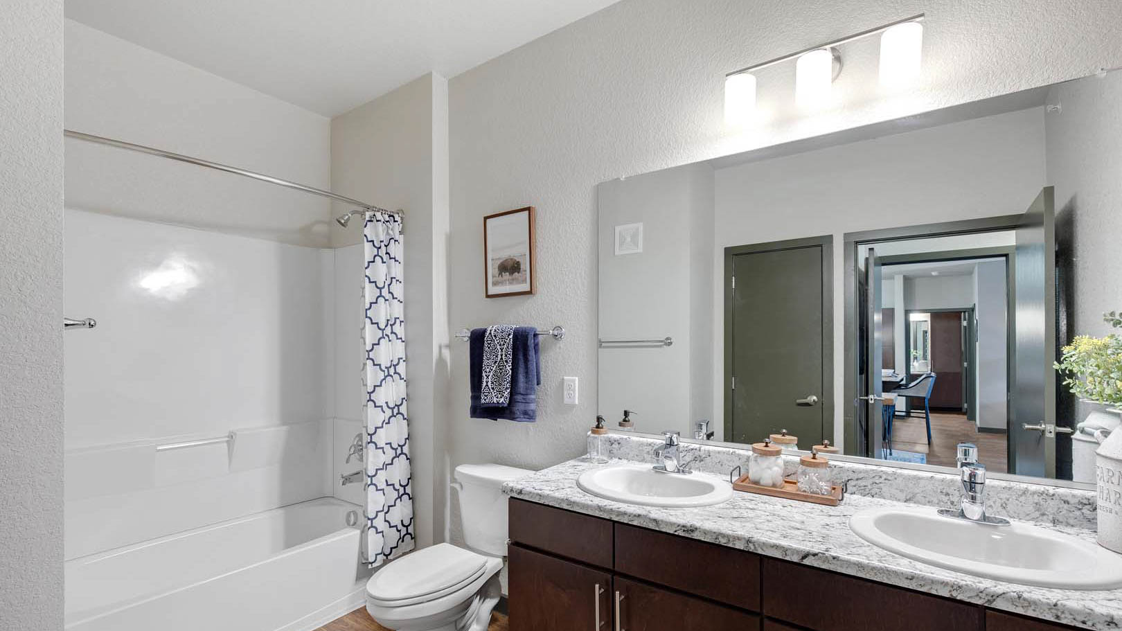 Bathroom with two sinks and standing shower at Springs in Round Rock in Austin Texas