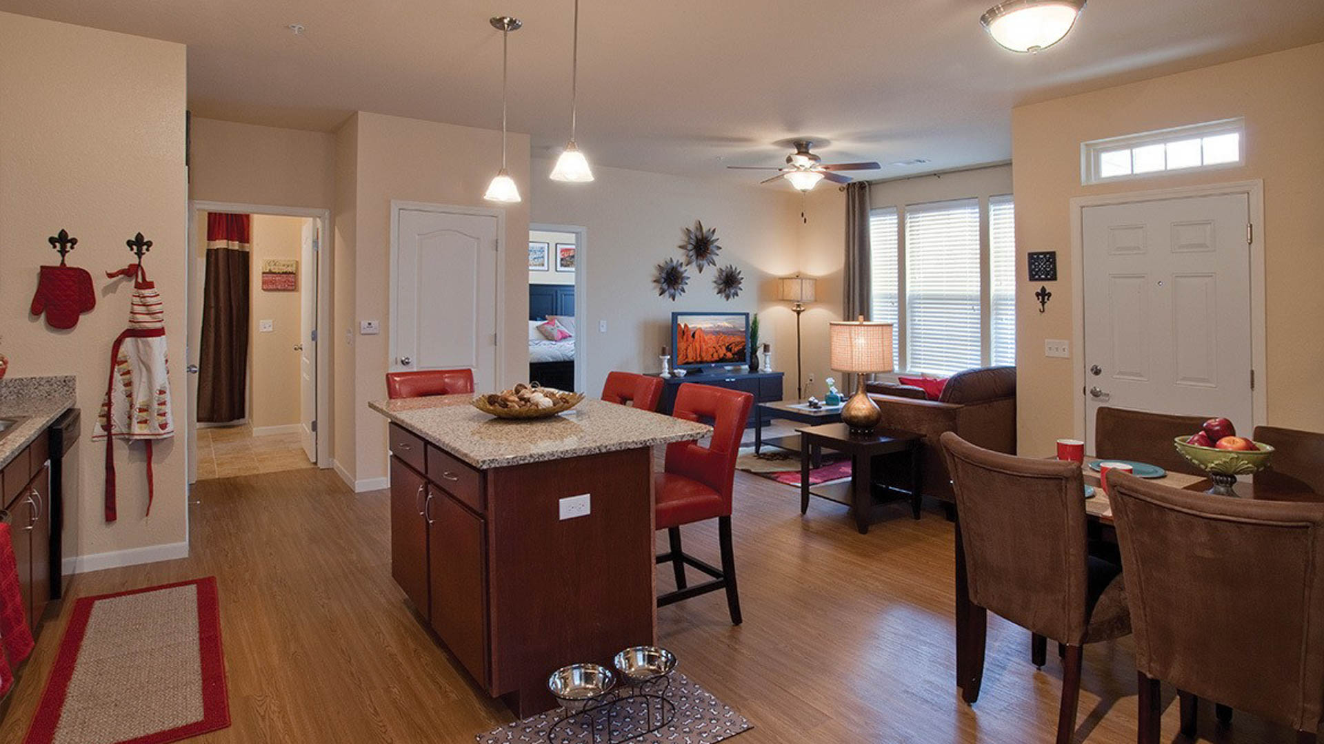 Living Room and Kitchen Island in Savage MN at Springs at Egan Drive Apartments-14