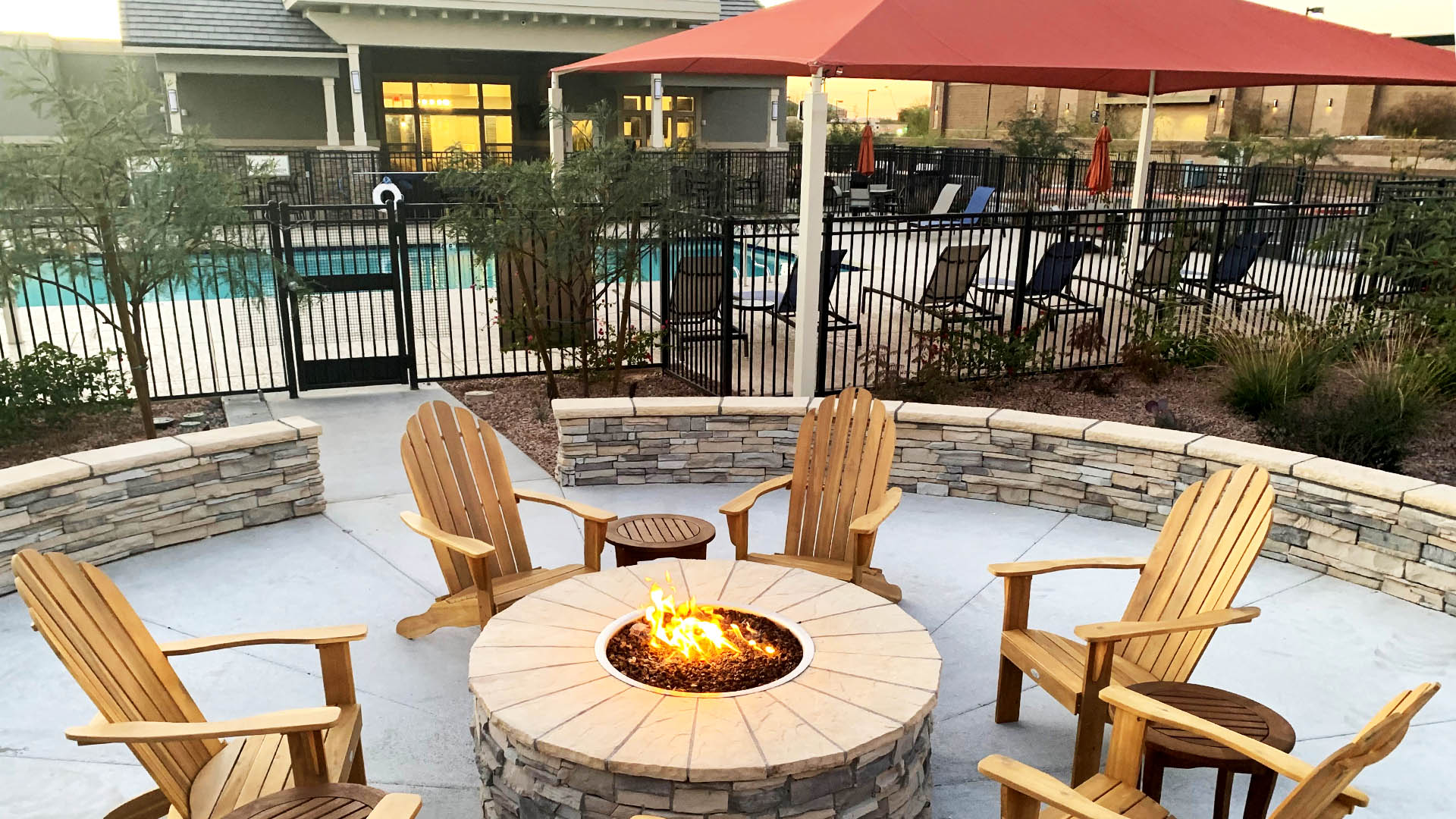 Fire pit near pool at Springs at Red Mountain Apartments