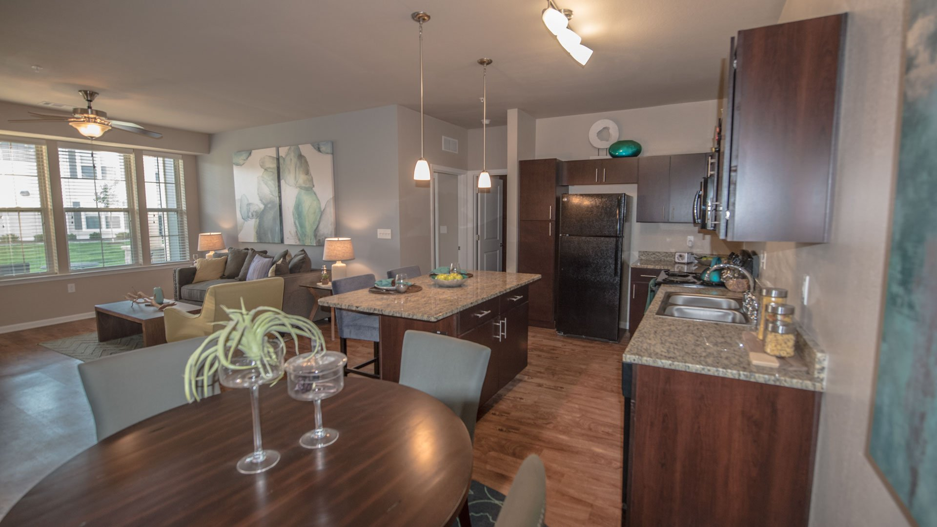 Open concept living room and kitchen at Springs at Kenosha apartments in Kenosha WI