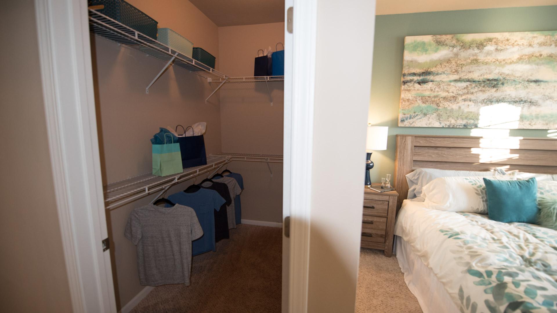 Walk-in closet and master bedroom at Springs at Kenosha apartments in Kenosha WI