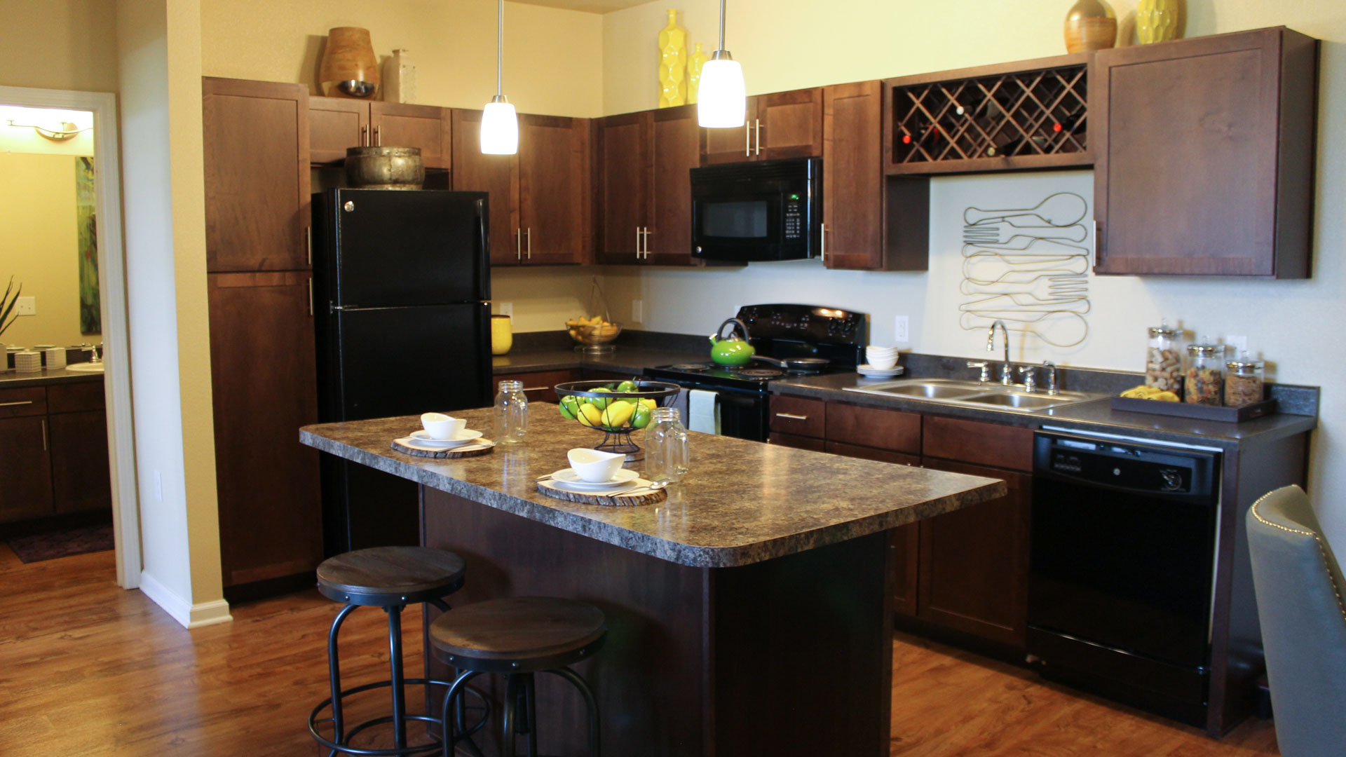 Kitchen with black appliances at Springs at Creekside in New Braunfels