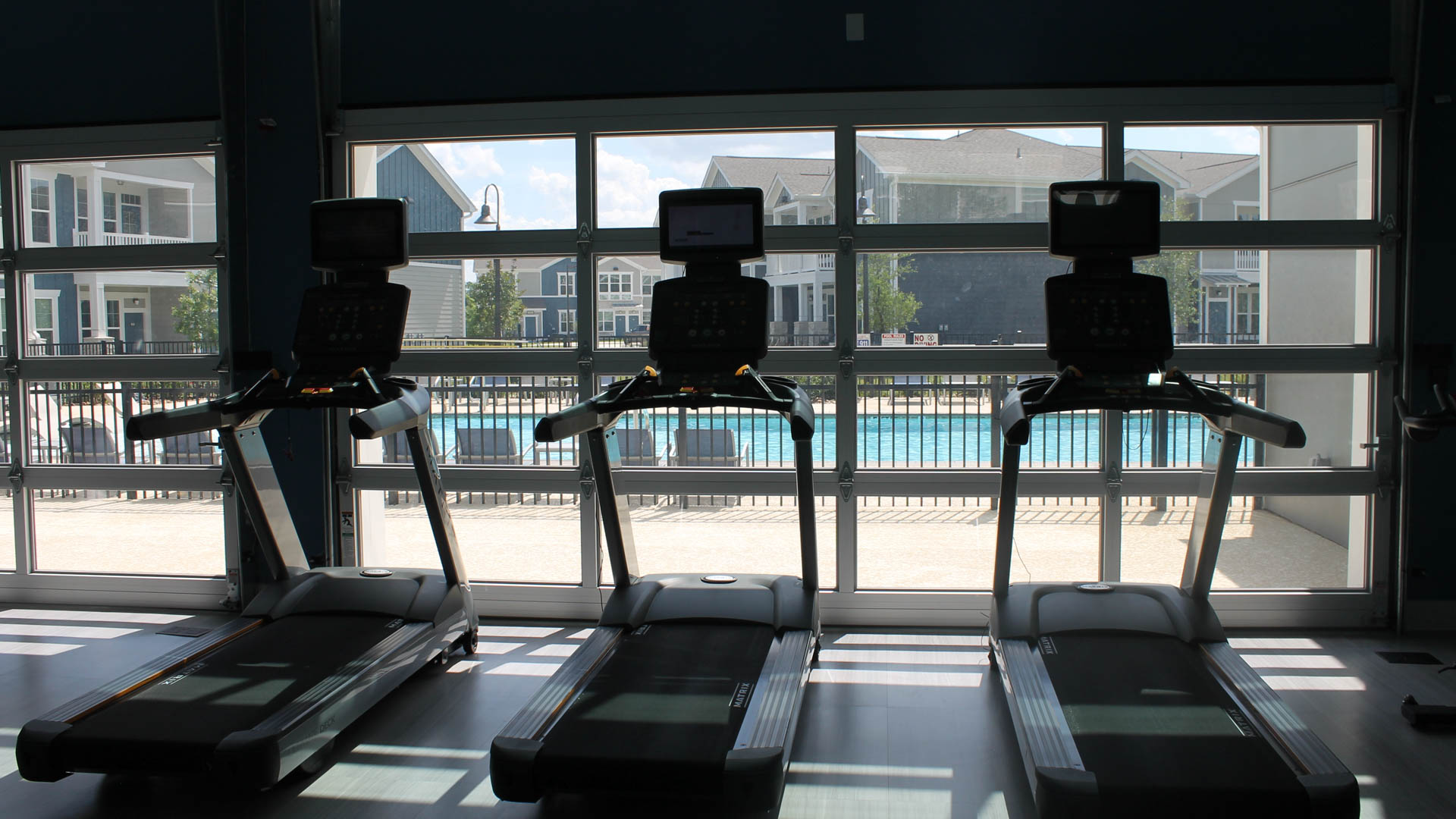 Gym that opens to the Pool in North Austin at Springs at Lakeline Apartments-21