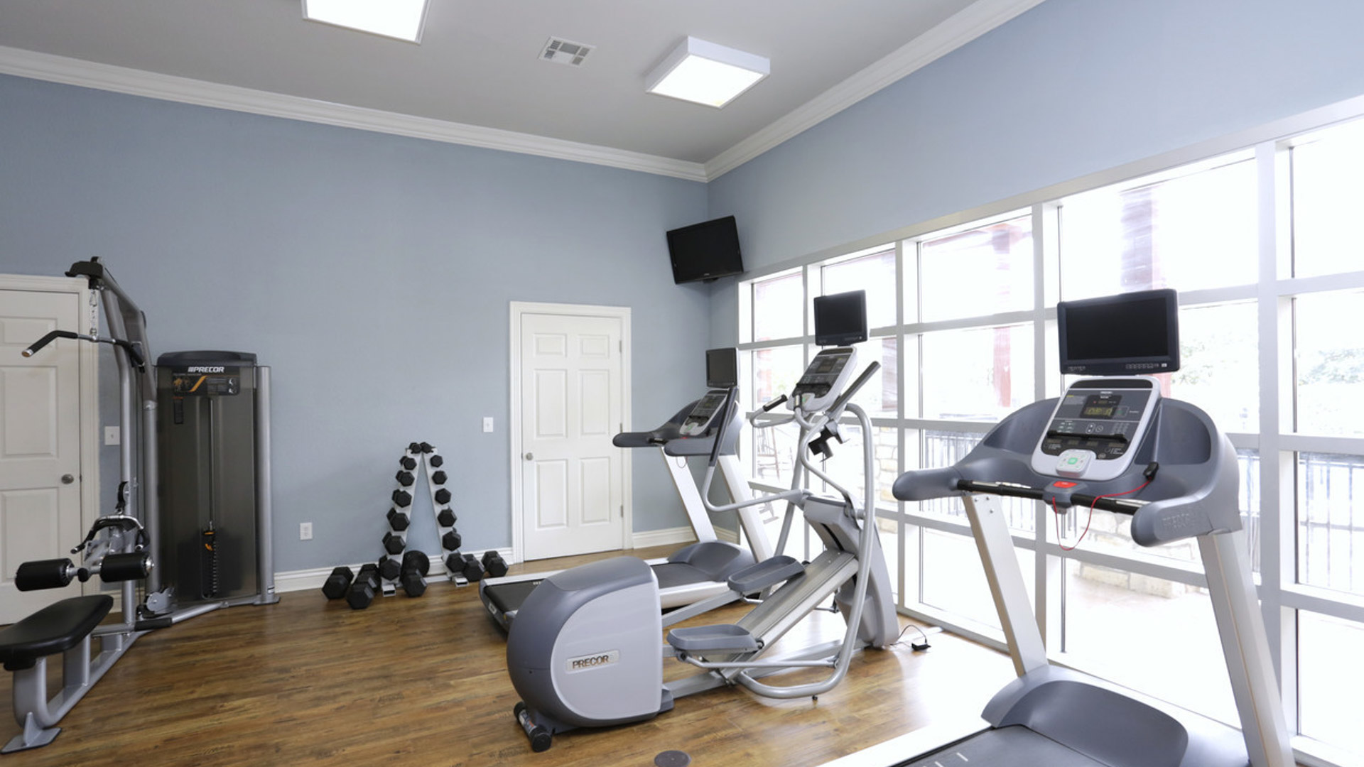 Treadmill and Free Weights at Springs at Live Oak in Live Oak