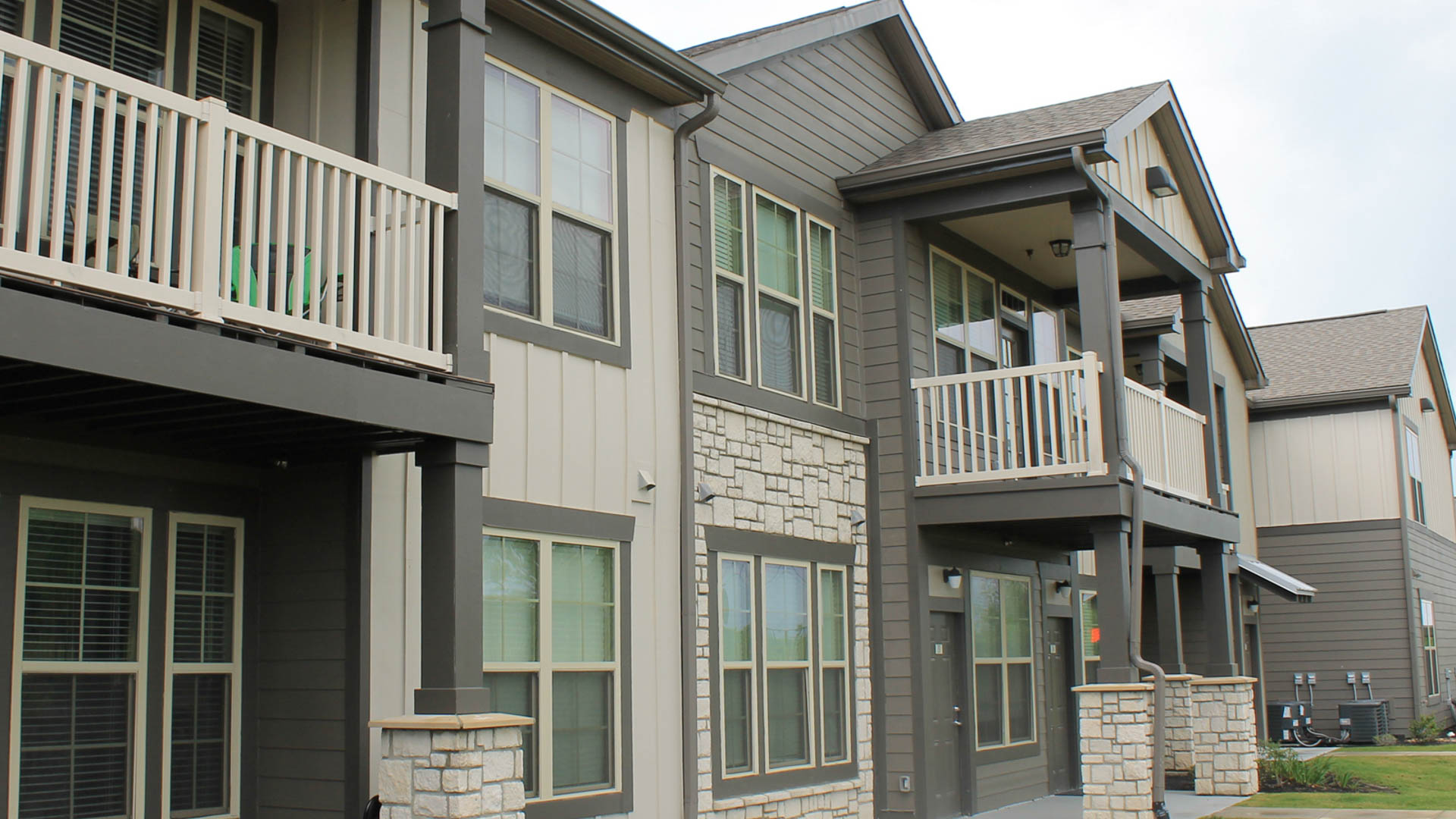 Apartment Exterior with Townhomes at Springs at University Drive Apartments in Bryan, Texas_-13