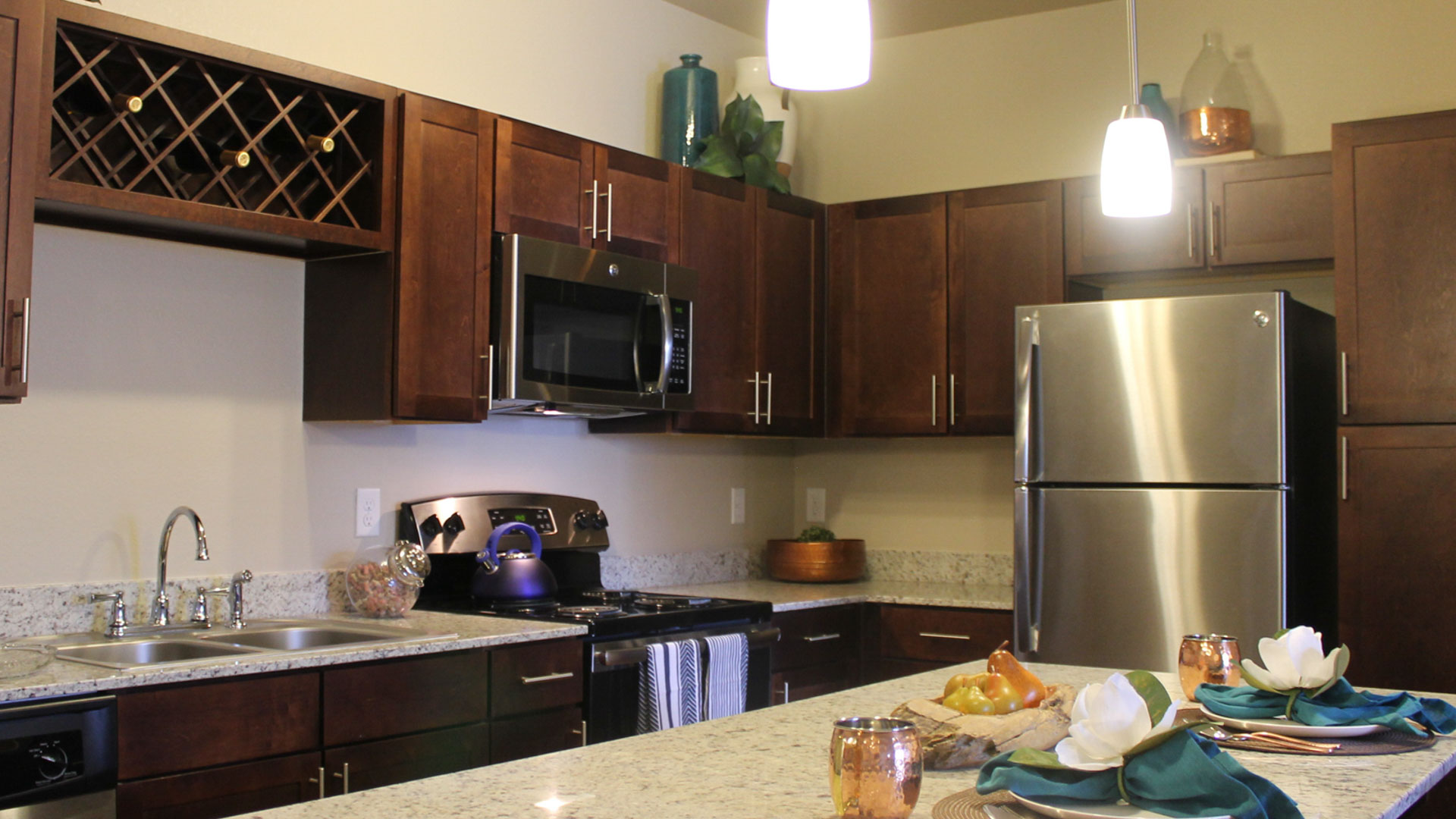Kitchen with Stainless Steel Appliances at Springs at University Drive Apartments in Bryan, Texas