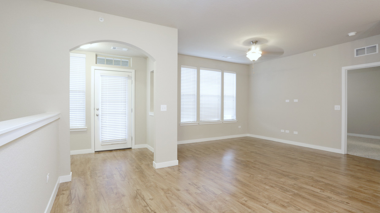 Bright open living room and nook in Romeoville, IL at Springs at Weber Road-79
