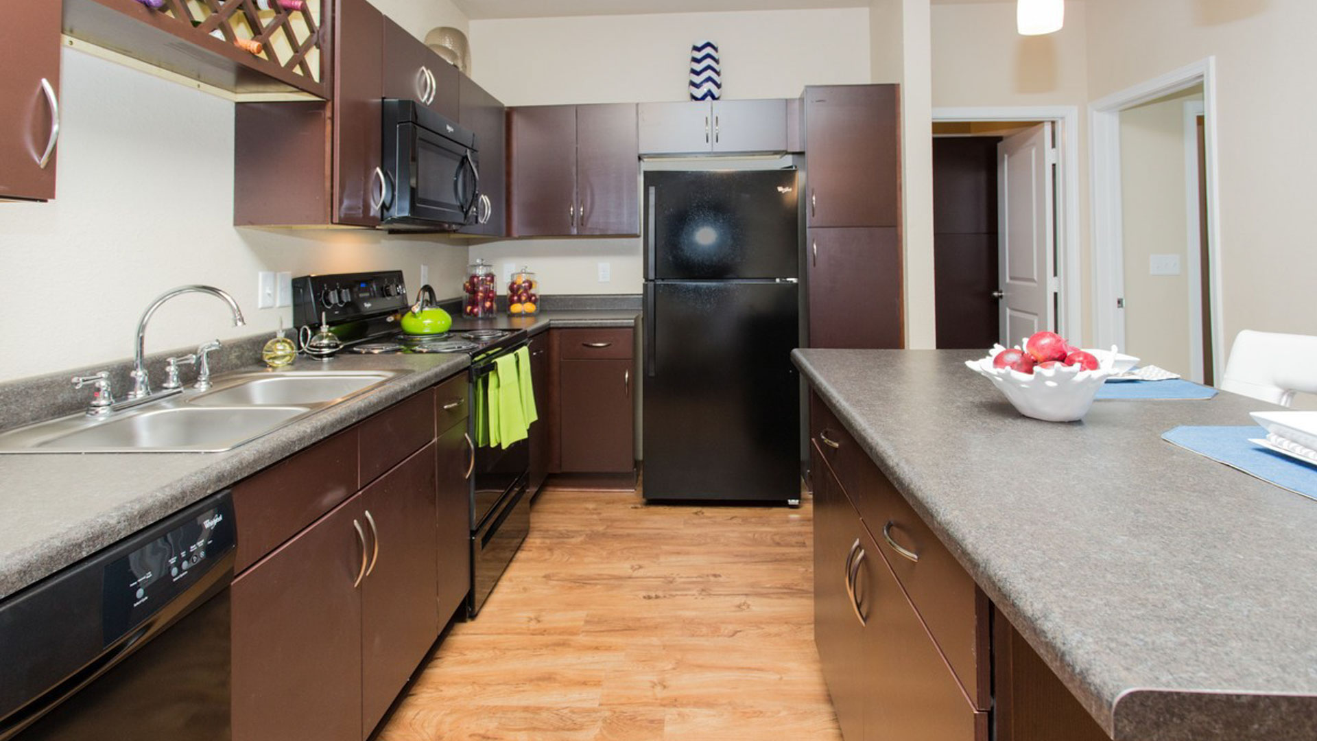 Kitchen with Black Appliances in Savage MN at Springs at Egan Drive Apartments-8
